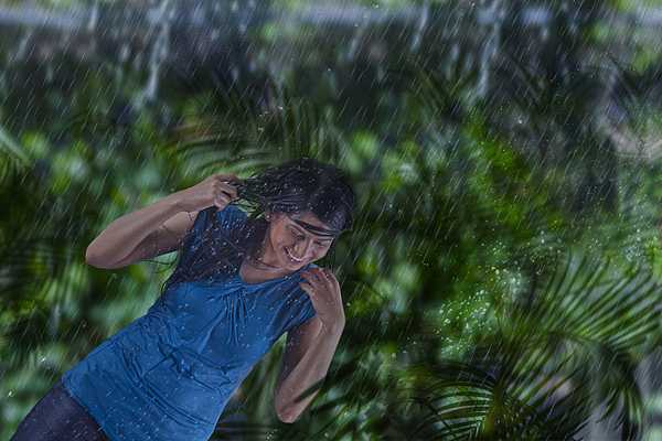 Woman enjoying in the rain Photograph by Abhinandita Mathur