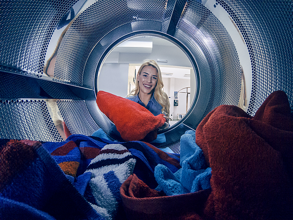 Young woman having a laundry day Photograph by Bluecinema