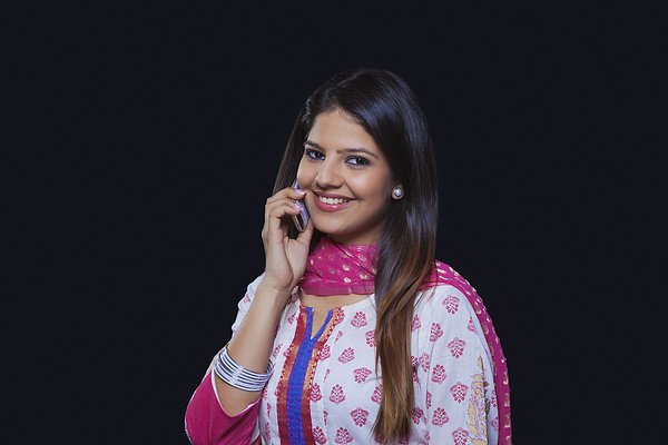 Young woman talking on her mobile phone Photograph by Ravi Ranjan