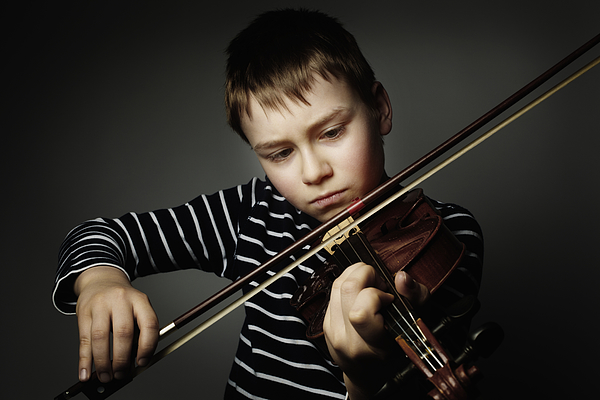 10 Year Old Playing The Violine Photograph by Silvia Otte