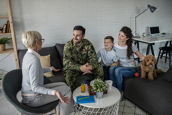 A Soldier And His Family At A Psychotherapist During A Session Photograph by Martinns