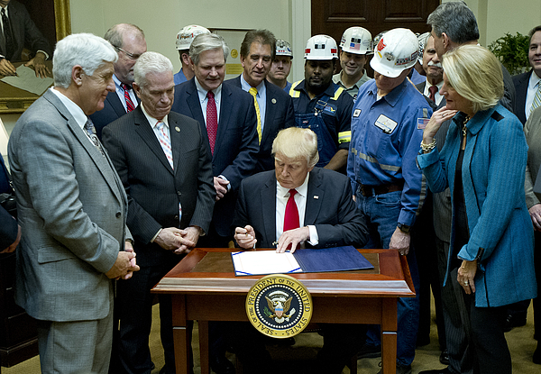 Donald Trump Sign Bill Eliminating Regulations On The Mining Industry Photograph by Pool