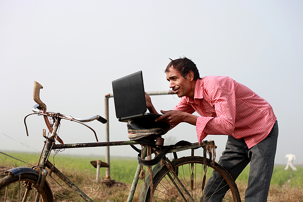 Farmer Using Laptop In The Field Photograph by Pixelfusion3d