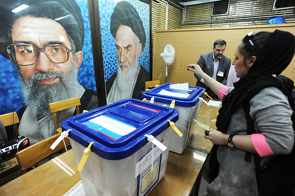Iranians Vote In Parliament And Assembly Of Experts Elections Photograph by Scott Peterson