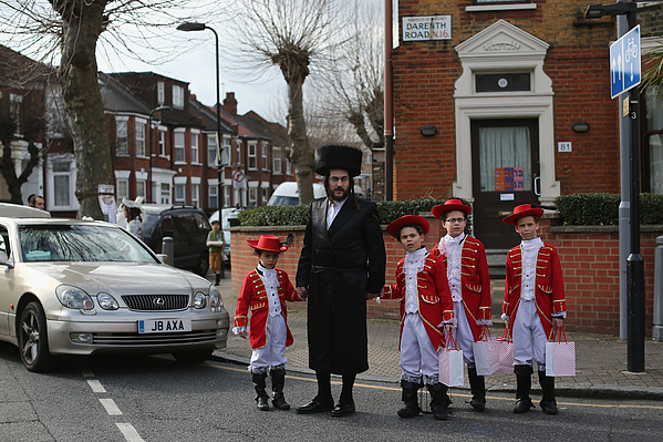 Londons Jewish Community Celebrate Purim Photograph by Dan Kitwood
