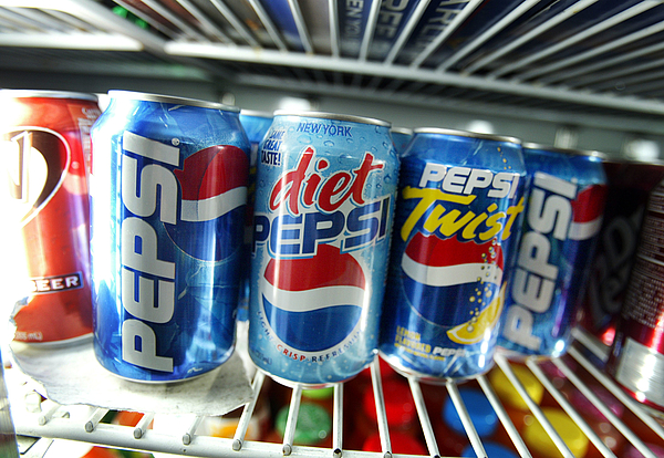 Pepsi Earnings Up In Q4 2002 Photograph by Mario Tama