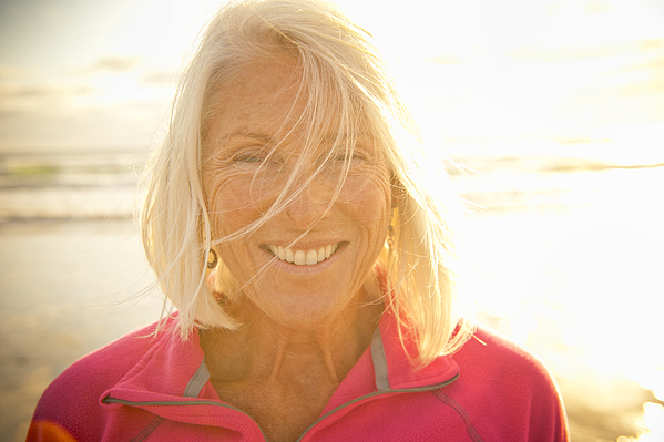 Portrait Of Fit senior Woman At The Beach Photograph by Stephen Simpson