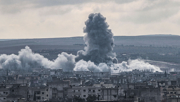 US-led coalition forces hit ISIL targets in Kobani Photograph by Anadolu Agency