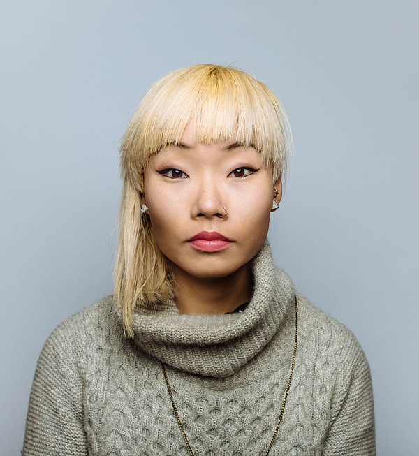 Portrait of Asian woman with blonde hair Photograph by Ian Ross Pettigrew