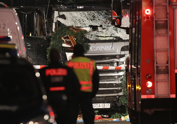 Lorry Drives Through Christmas Market In Berlin Photograph by Sean Gallup