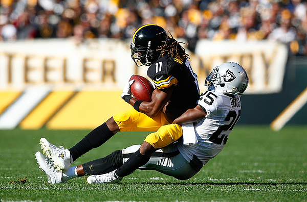 Oakland Raiders v Pittsburgh Steelers Photograph by Jared Wickerham