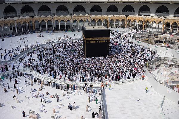Muslim Pilgrims Circumambulate Or tawaf The Kaabah After Subuh Prayer At Masjidil Haram Photograph by Shaifulzamri