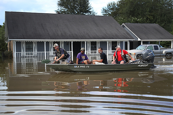 Torrential Rains Bring Historic Floods To Southern Louisiana Photograph by Joe Raedle