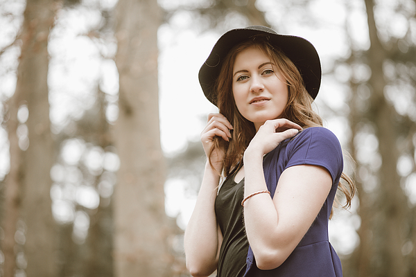 Beautiful young woman in the woods Photograph by Theasis