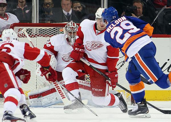Detroit Red Wings v New York Islanders Photograph by Bruce Bennett