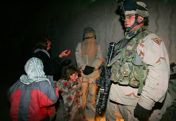 U.S. Troops Mistakenly Kill Iraqi Civilians Photograph by Chris Hondros