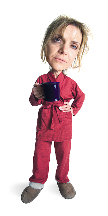 A Blonde Caucasian Woman Wearing Slippers And Red Pajamas With A Red Robe Holds Her Mug And Looks Very Sleepy And People Photograph by Photodisc