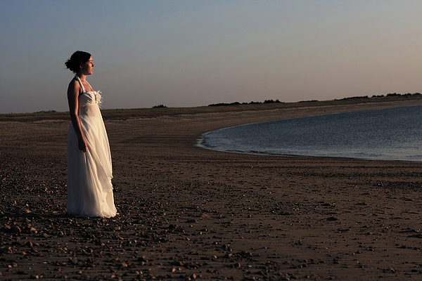 A bride on the beach Photograph by by Ludovic Toinel