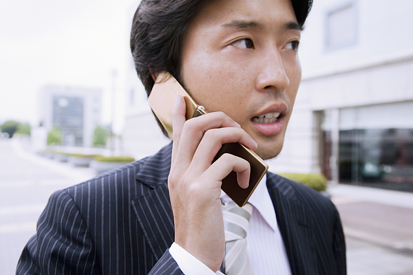 A Business Man Talking On Cell Phone Photograph by Kohei Hara