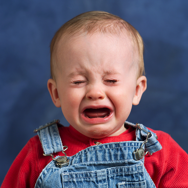 A Caucasian Baby Begins To Cry Loudly Photograph by Photodisc