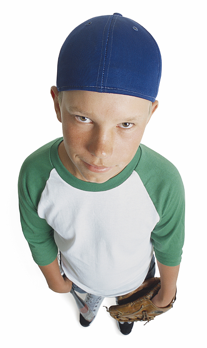 A Caucasian Male Preteen In A Green And White Shirt And Blue Cap Holds His Mitt And Smirks Looking Up Towards The Camera Photograph by Photodisc