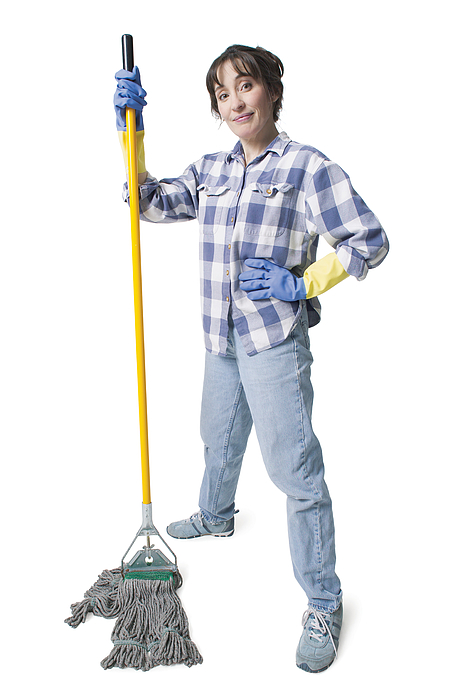 A Caucasian Woman In Jeans And A Plaid Shirt Wears Rubber Gloves And Holds A Mop Photograph by Photodisc