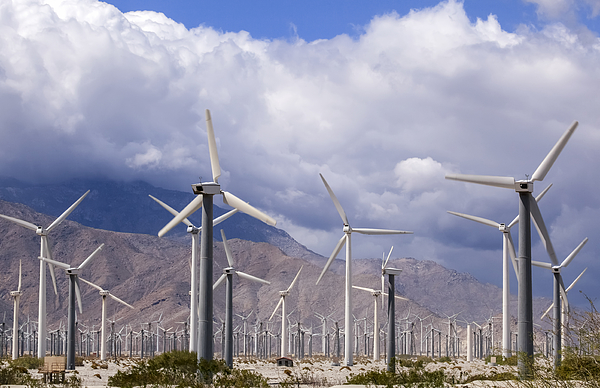 A Field Of Wind Generators With Mountains And Clouds In The Background, A Common Sight In California Photograph by Timothy Hearsum / Design Pics