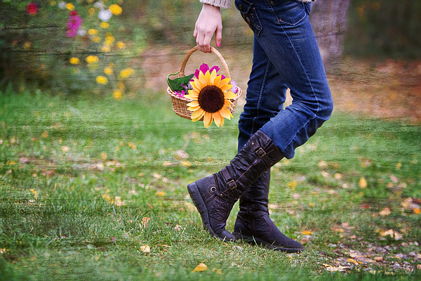 A girl walking with a basket of flowers Photograph by Kelly Sillaste