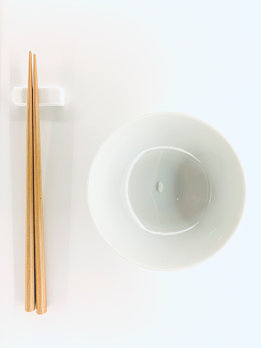 a grain Rice with Chopsticks Photograph by Liyao Xie