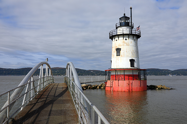 A lighthouse with a red base and a white tower in the Hudson River Photograph by Rainer Grosskopf