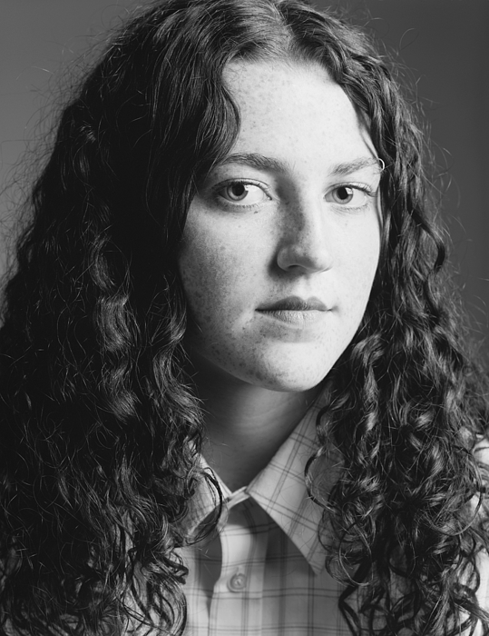 A Long Curly Haired Caucasian Teen With Attitude Glares At The Camera Photograph by Photodisc