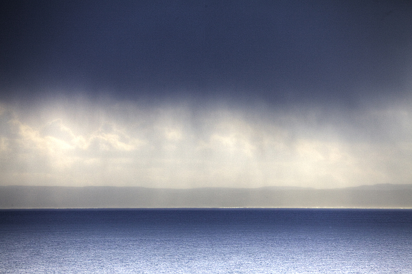 A Rainstorm Over The Atlantic Ocean Photograph by GeoStock