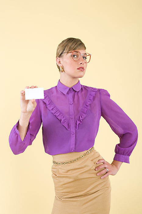 A woman holding a business card Photograph by Image Source
