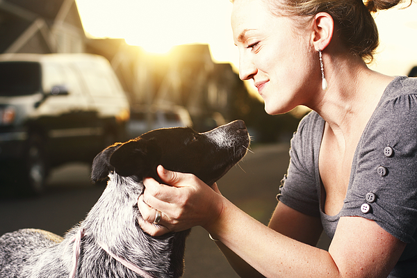 A woman touching the neck of her dog Photograph by CaseyHillPhoto