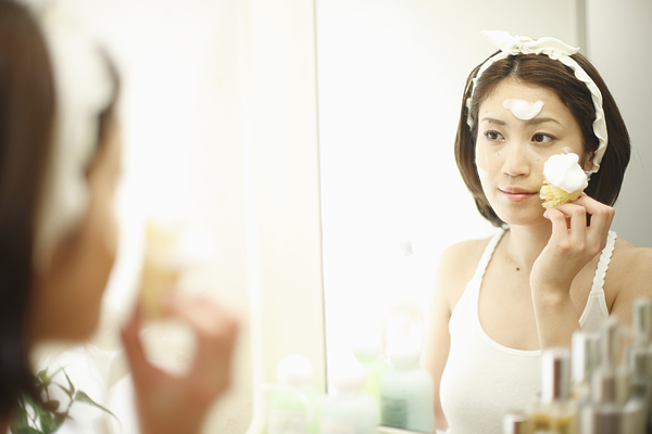 A woman washing her face Photograph by Imagenavi