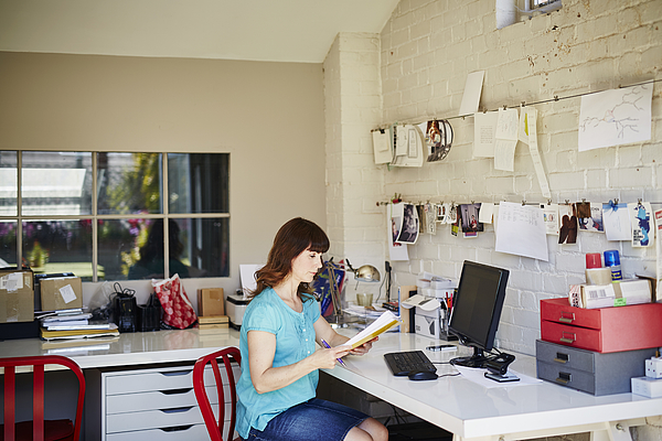 A woman works from her home office Photograph by Kelvin Murray