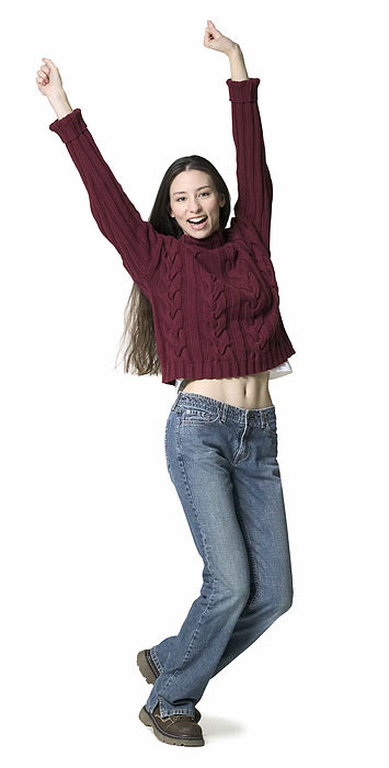 A Young Adult Female In Jeans And A Red Sweater Throws Up Her Arms While Dancing Photograph by Photodisc