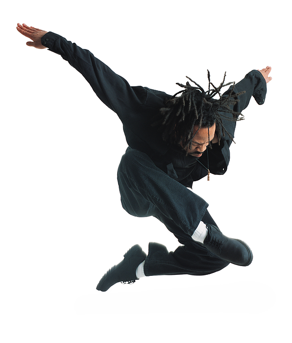 A Young African American Male Modern Dancer In Black Pants And Shirt Leaps Up And Flies Through The Air While Outstretching His Arms Photograph by Photodisc