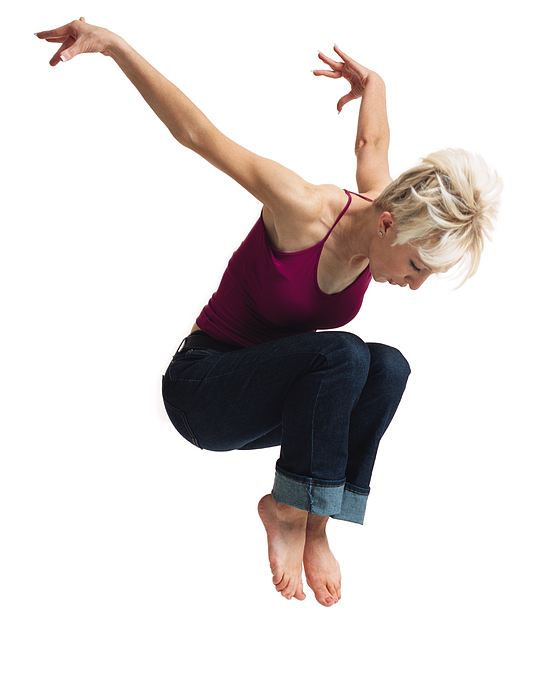 A Young Caucasian Blonde Female In Jeans And A Purple Tank Top Leaps Into The Air And Throws Her Arms Up Behind Her Photograph by Photodisc