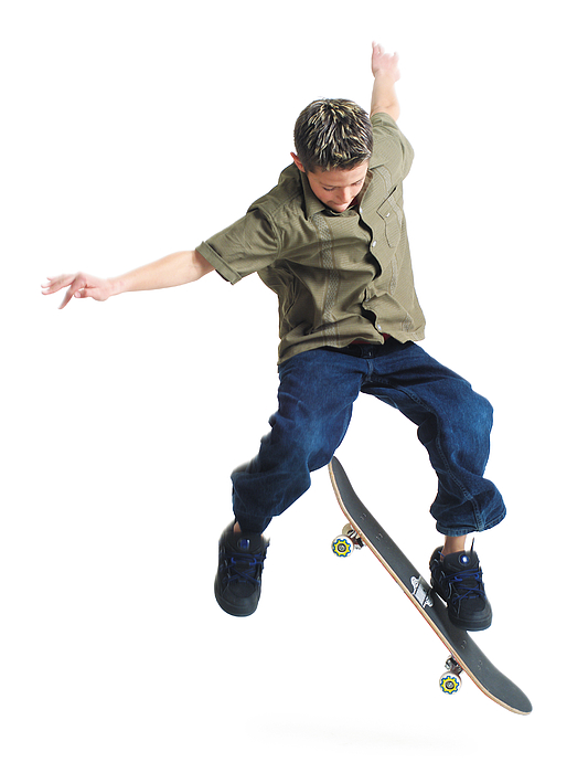 A Young Caucasian Boy Does Tricks On His Skateboard Photograph by Photodisc