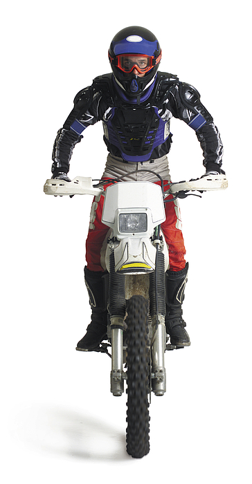 A Young Caucasian Male Dirtbiker Sits Upon His Motorcycle And Races Forward Photograph by Photodisc