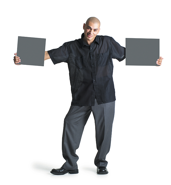A Young Hispanic Male Wearing Grey Slacks And A Black Shirt Stretches His Arms Out To Hold Two Blank Signs As He Smiles At The Camera Photograph by Photodisc