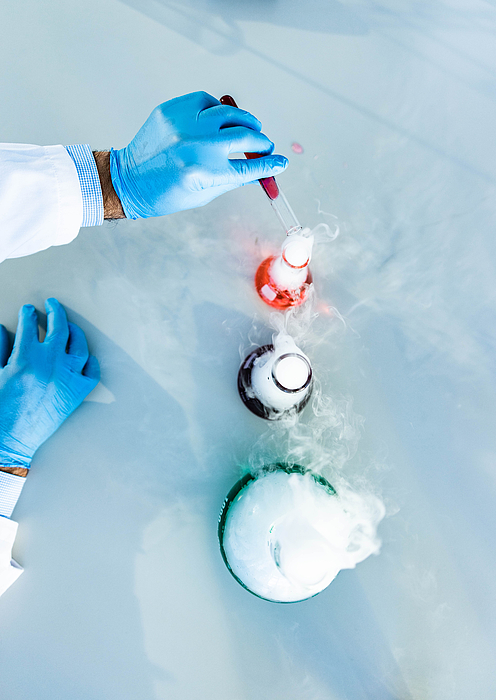 Above view of mixing poisonous chemical liquids in laboratory. Photograph by Skynesher