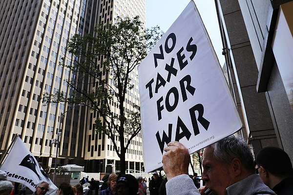 Activists Protest Tax Dollars Being Spent On U.S. Wars At NYC IRS Building Photograph by Spencer Platt