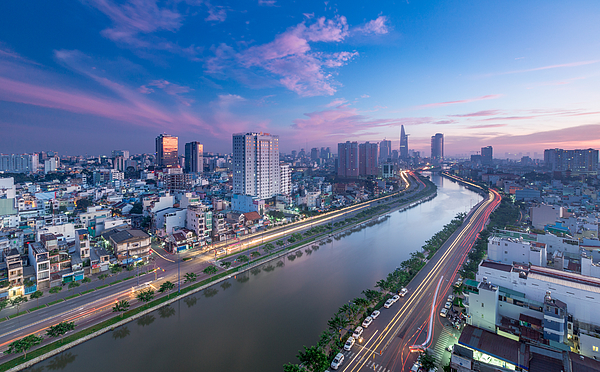 Aerial Sunset View Of Houses And Business And Administrative Center Of Ho Chi Minh City On Nhieu Loc Canal Photograph by Ho Ngoc Binh