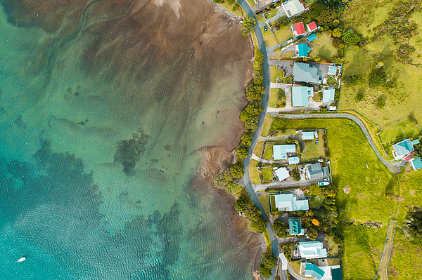 Aerial view of houses along the beach. Photograph by Nazar Abbas Photography