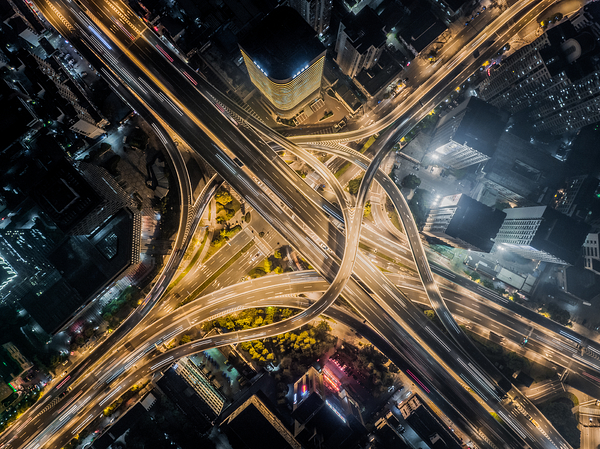 Aerial view of road interchange at night Photograph by Sino Images