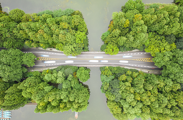 Aerial view of road over West Lake Photograph by Liyao Xie