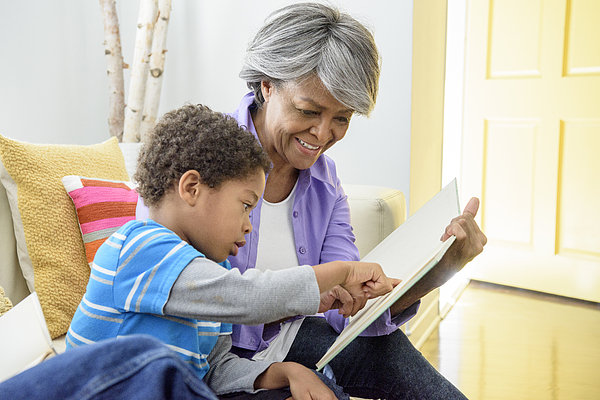 African American Grandmother Showing Book To Grandson, Smiling Photograph by Johnny Greig