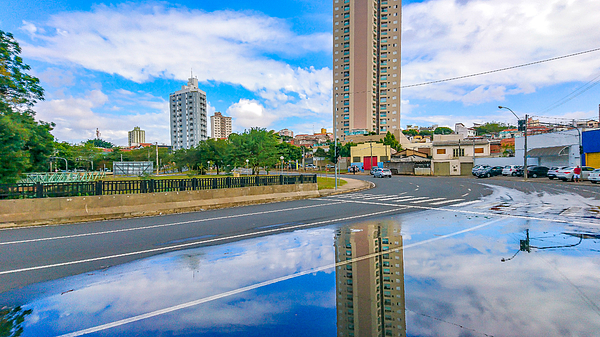 After the rain the reflection reveals the beauty of the city. Photograph by CRMacedonio